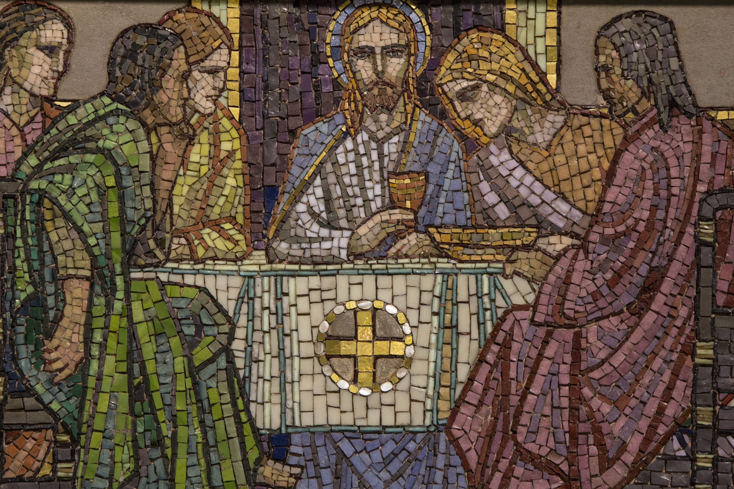 A mosaic of Christ with a plate and cup, depicting the institution of the Eucharist or Lord's Supper.