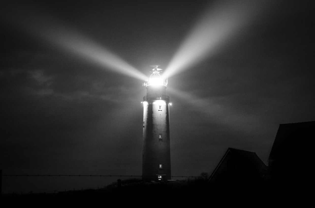 Light from a lighthouse shining in the dark