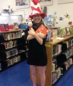 A lunatic librarian dressed as the Cat in the Hat