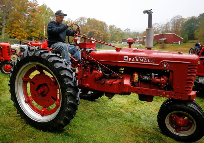 Tractor Going Right On Man : The right to repair men of west